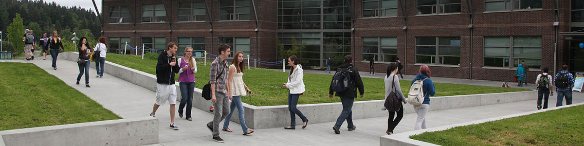 Students walk the campus sidewalks at Cascadia College