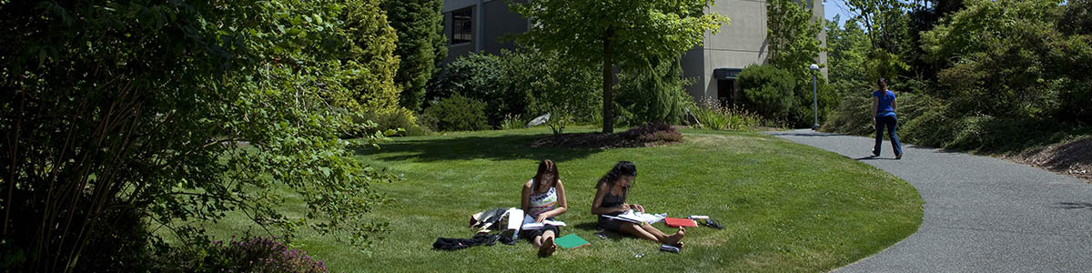 Students relax on the grass at Edmonds Community College